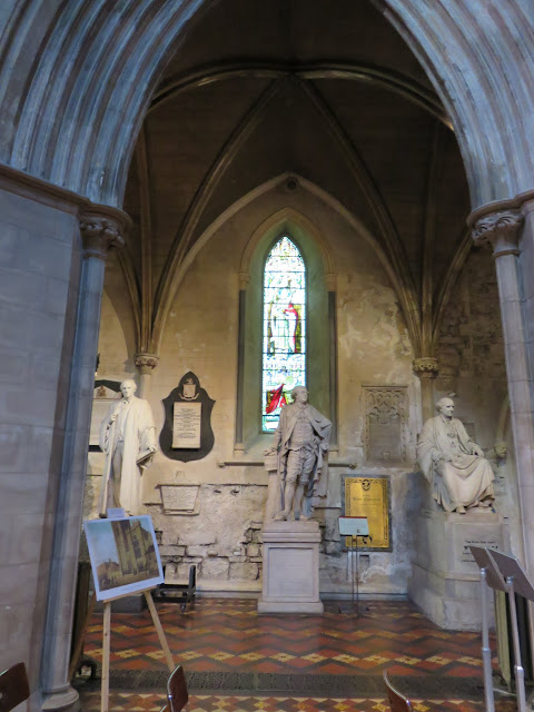Statues and stained glass in an alcove in St. Patrick's Cathedral in Dublin