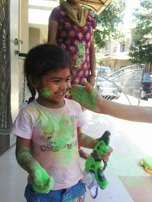 Shubhi playing holi