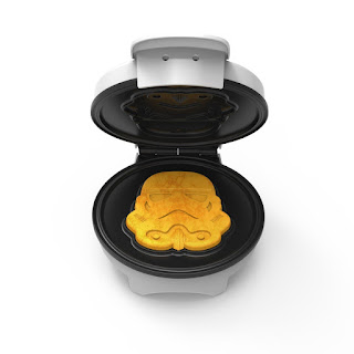 A white waffle maker that makes storm trooper shaped waffles.
