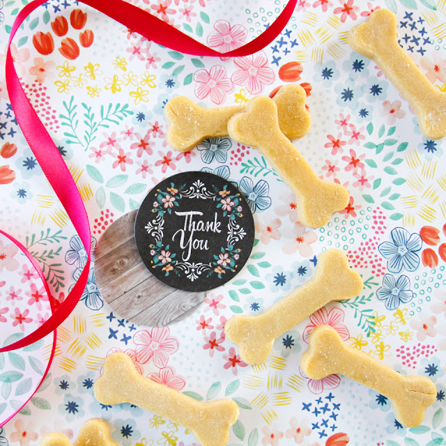 "Homemade dog treats with ribbon a flowered gift tag that says ""Thank You"""