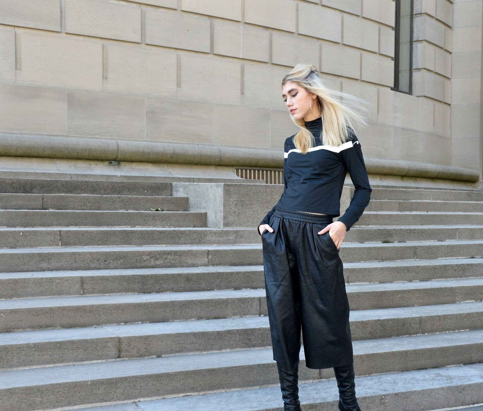 In a Chic athleisure inspired outfit posing in Chicago