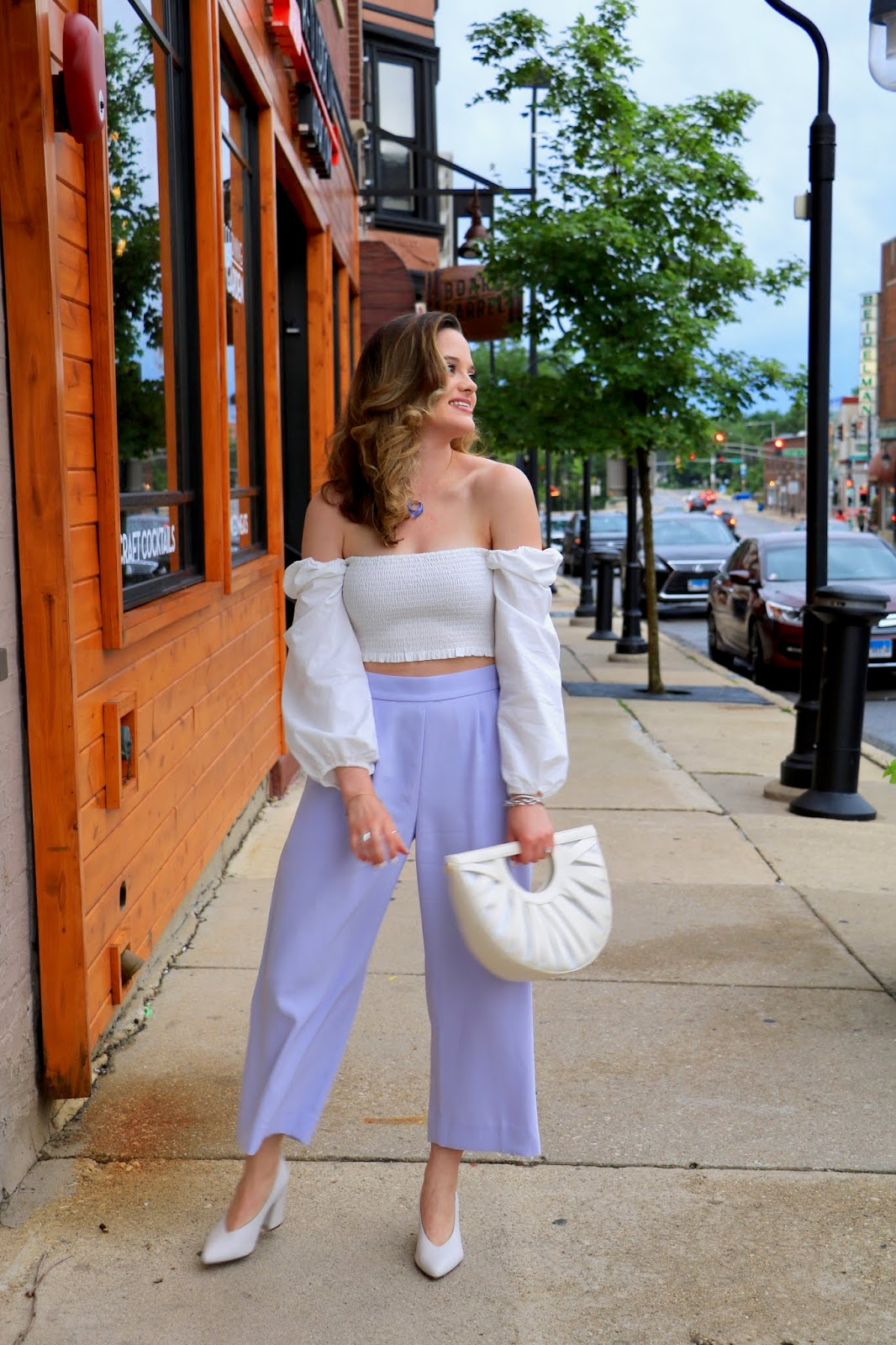 Nyc fashion blogger Kathleen Harper wearing an off-the-shoulder top with high-waisted pants from J.Crew.