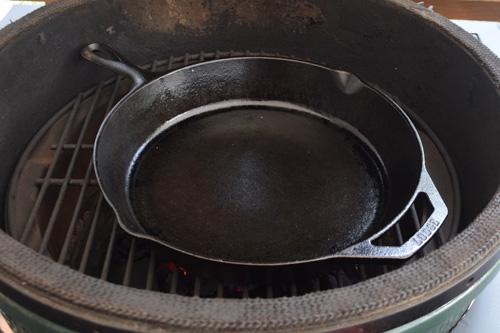 "Lodge 10.25"" skillet on a Big Green Egg kamado grill"