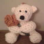 https://www.lovecrochet.com/valentine-teddy-bear-with-a-rose-crochet-pattern-by-peachunicorn