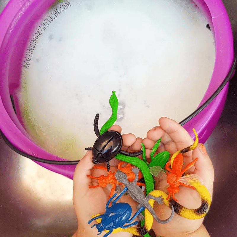 adding plastic bugs to witches brew