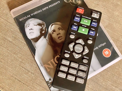 The DVD player remote sitting on the dvd of nightbirds