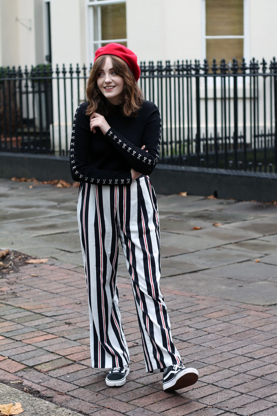 autumn outfit by Liverpool fashion blogger featuring red beret, black long sleeve crop jumper, red, white and black striped trousers and black vans old skool trainers