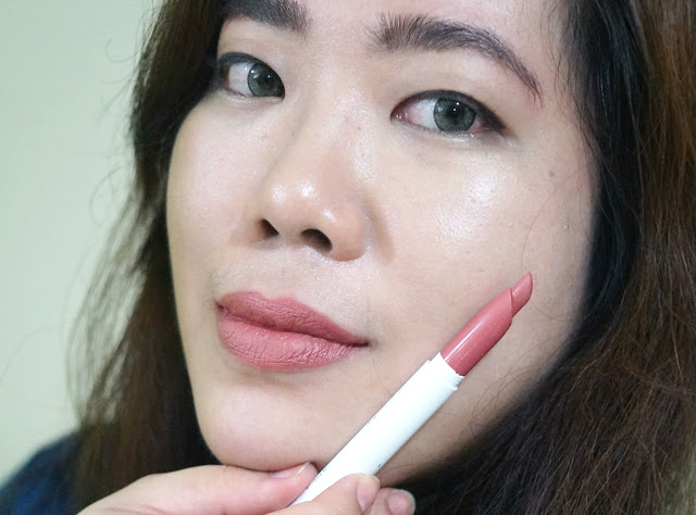 On lips: Colourpop Lippie Stix in Brink