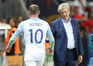 England coach Roy Hodgson salutes Wayne Rooney as he leaves the pitch to be replaced during the Euro 2016 round of 16 soccer match between England and Iceland, at the Allianz Riviera stadium in Nice, France, Monday, June 27, 2016.