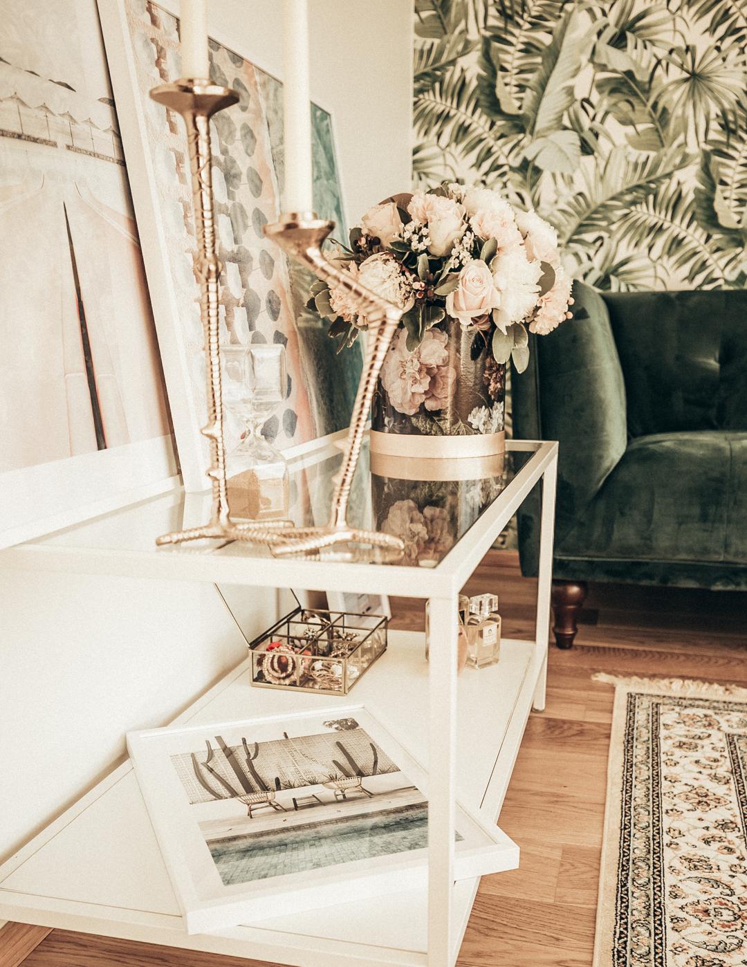 interior design home decor green velvet couch palm tree wallpaper