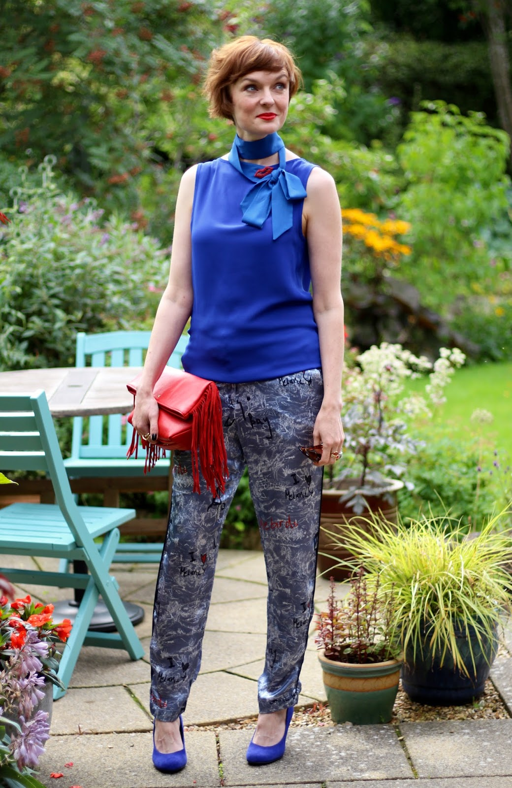 Fake Fabulous | Cobalt blue top (worn back to front), pyjama trousers, red lips and blue heels.