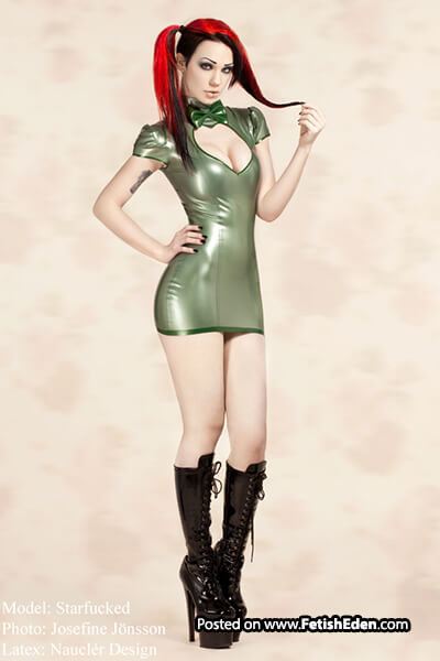 Red hair Starfucked wearing green latex mini-dress and long black PVC boots