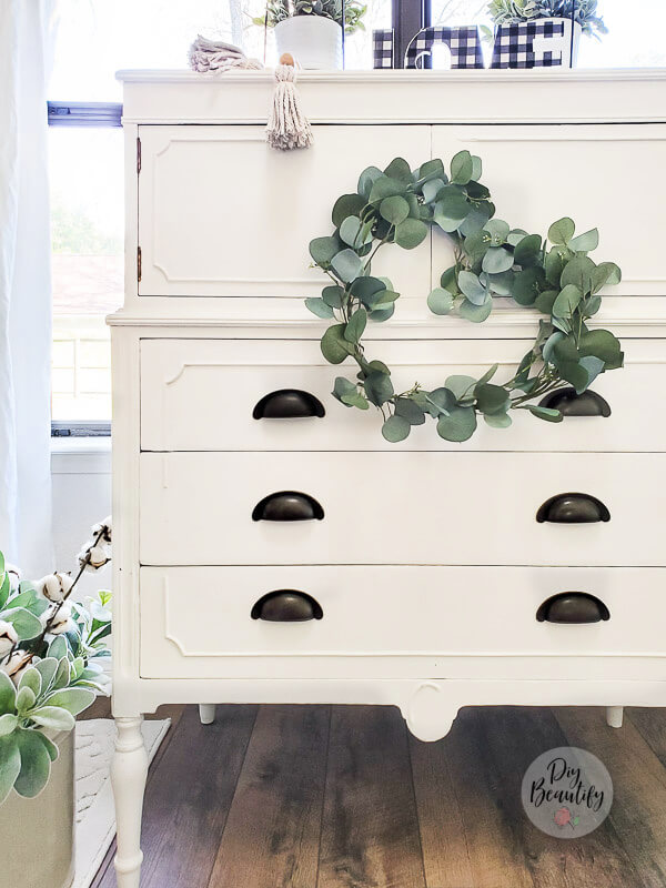cottage dresser and eucalyptus wreath