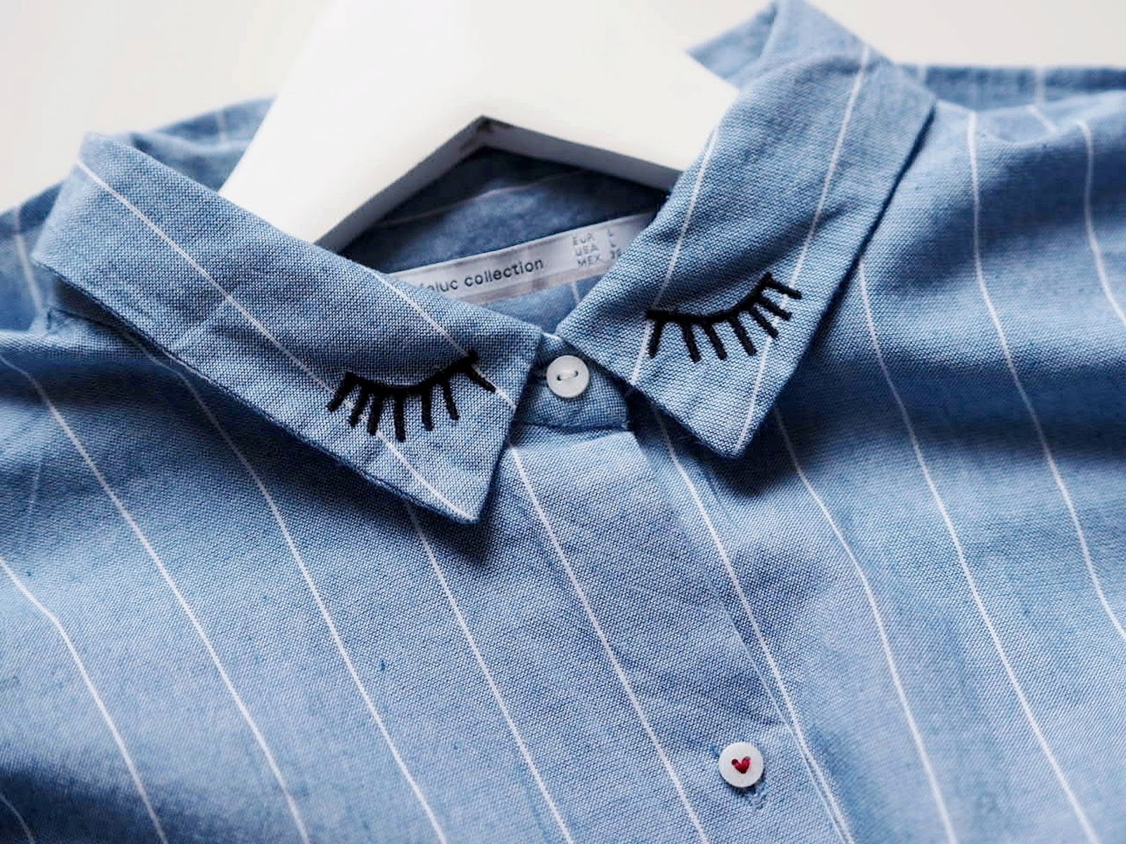 shirt with eye details on the collar
