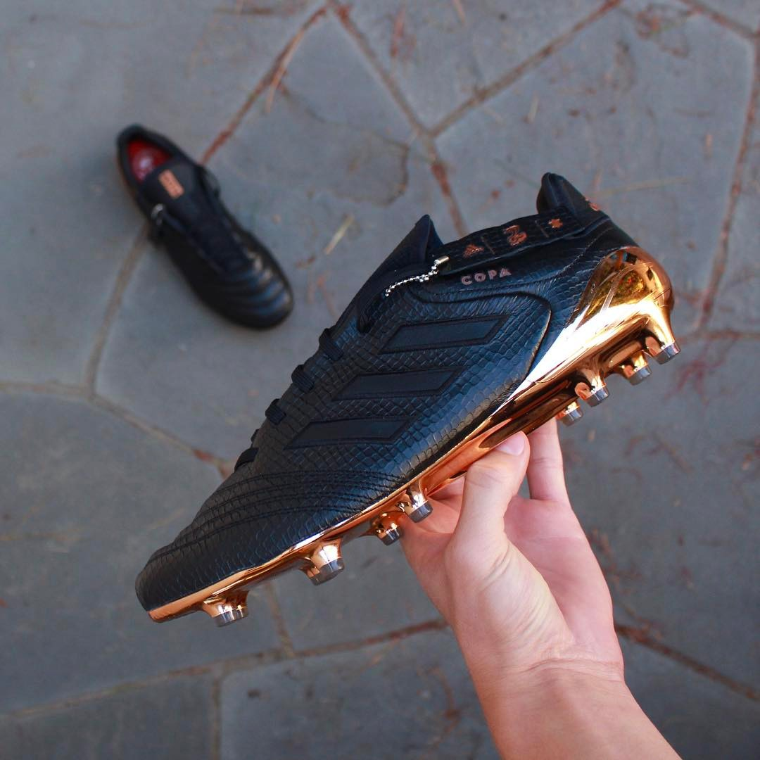 2322275d4dbab ... This image shows the black and gold Adidas x Kith Copa 17 soccer boot.
