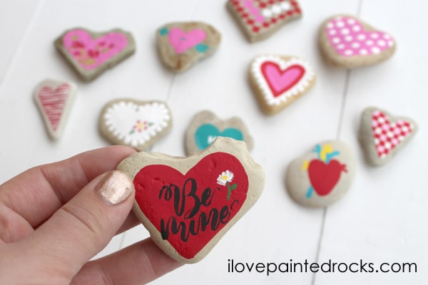 Be Mine heart rock for Valentine's Day - how to paint rocks for valentines day with these 11 rock painting ideas.