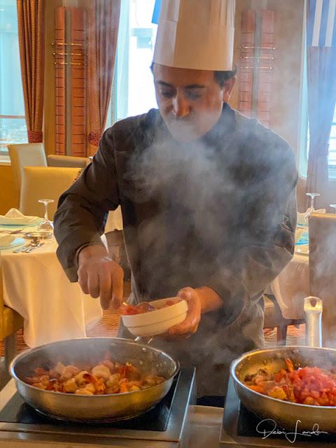 Chef adds the tomato sauce.