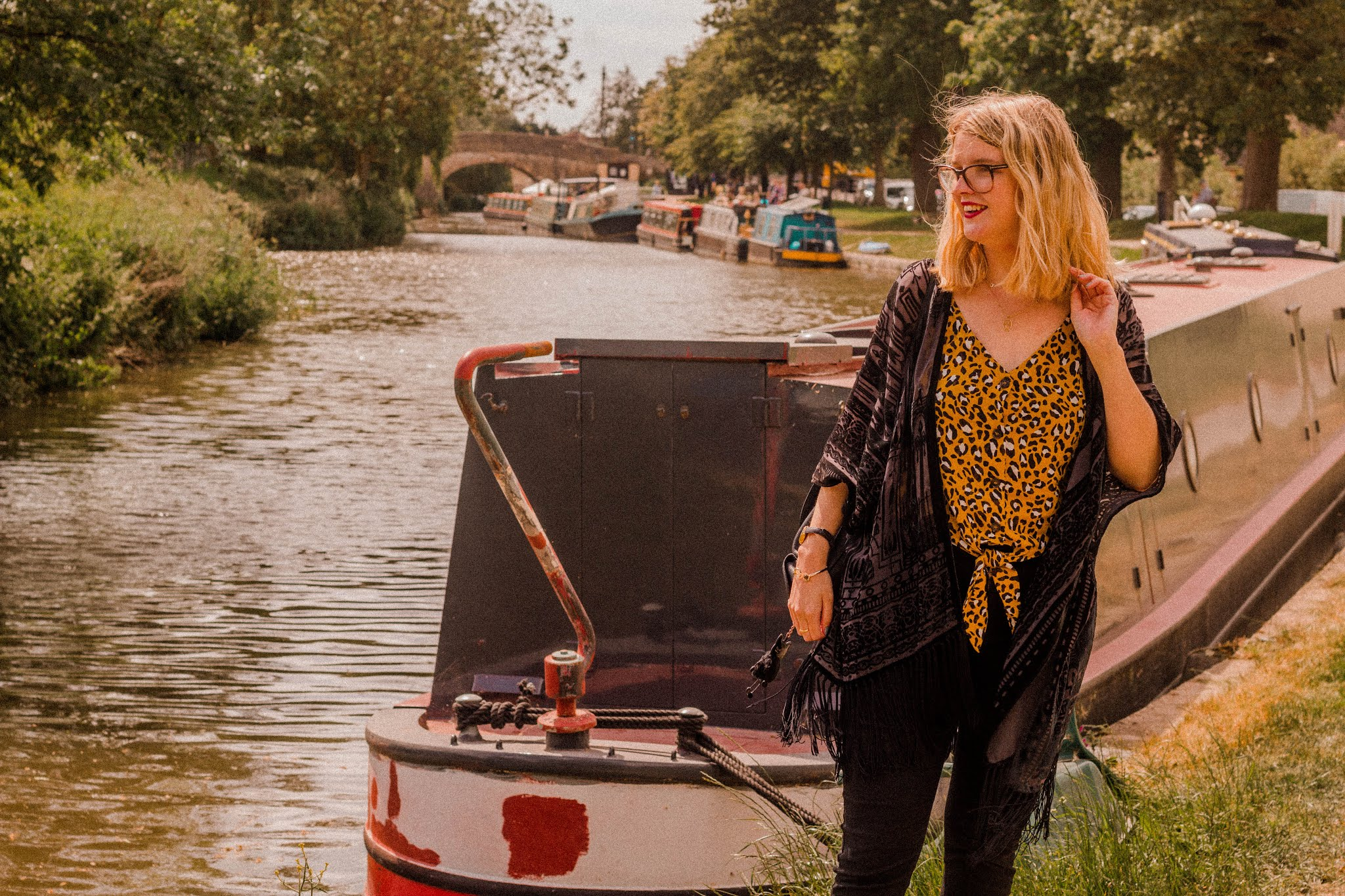 Blonde Girl by Water, wearing jeans and kimono & leopard tee - 2019 goals 6 month review