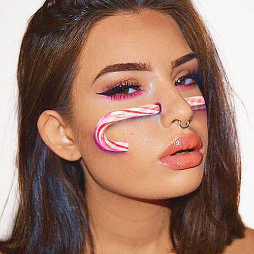 Maquillaje 3D con palo de caramelo blanco y rojo