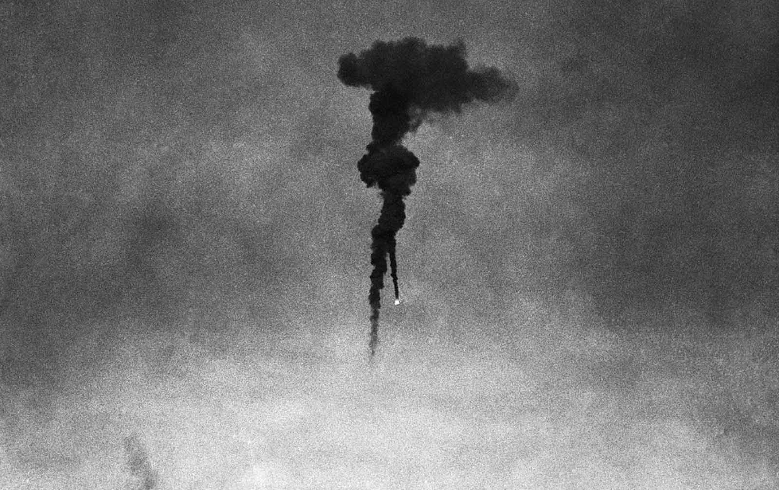 Two barrage balloons come down in flames after being shot by German war planes during an aerial attack over the Kent coast in England, on August 30, 1940.