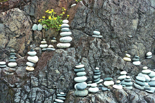 Columns of rocks created by beachcombers...
