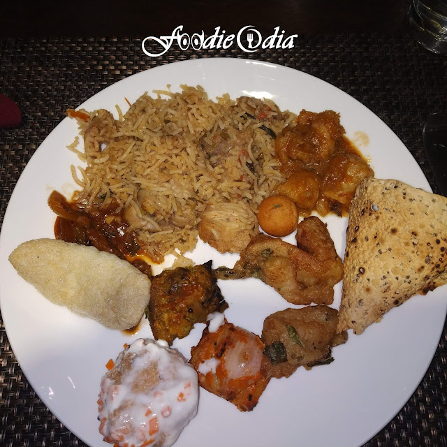 Delicious Food plate filled with Chicken Biriyani, Mutton Curry, DahiVada, Papad, Fish fry on the occasion of Chhadakhai