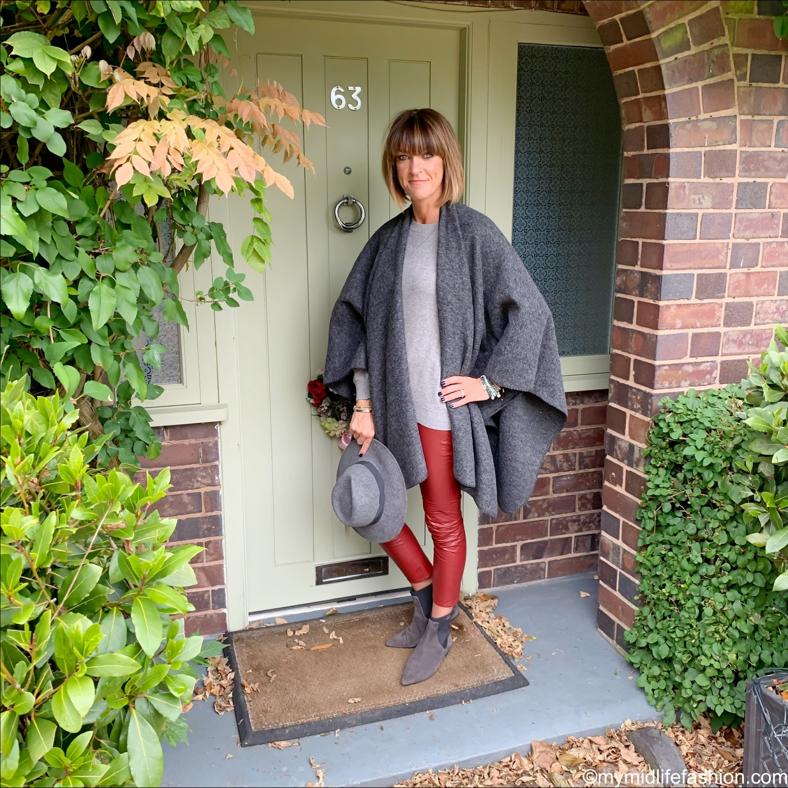 my midlife fashion, Zara felt fedora hat, Chanel vintage brooch, h and m cashmere sweatshirt jumper, Isabel Marant Etoile faux leather trousers, Madeleine fashion ankle boots, the sea company mindful stack bracelets, hope fashion the boiled wool blanket poncho