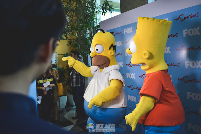 Meet and greet with The Simpsons and take photos together at the photobooth