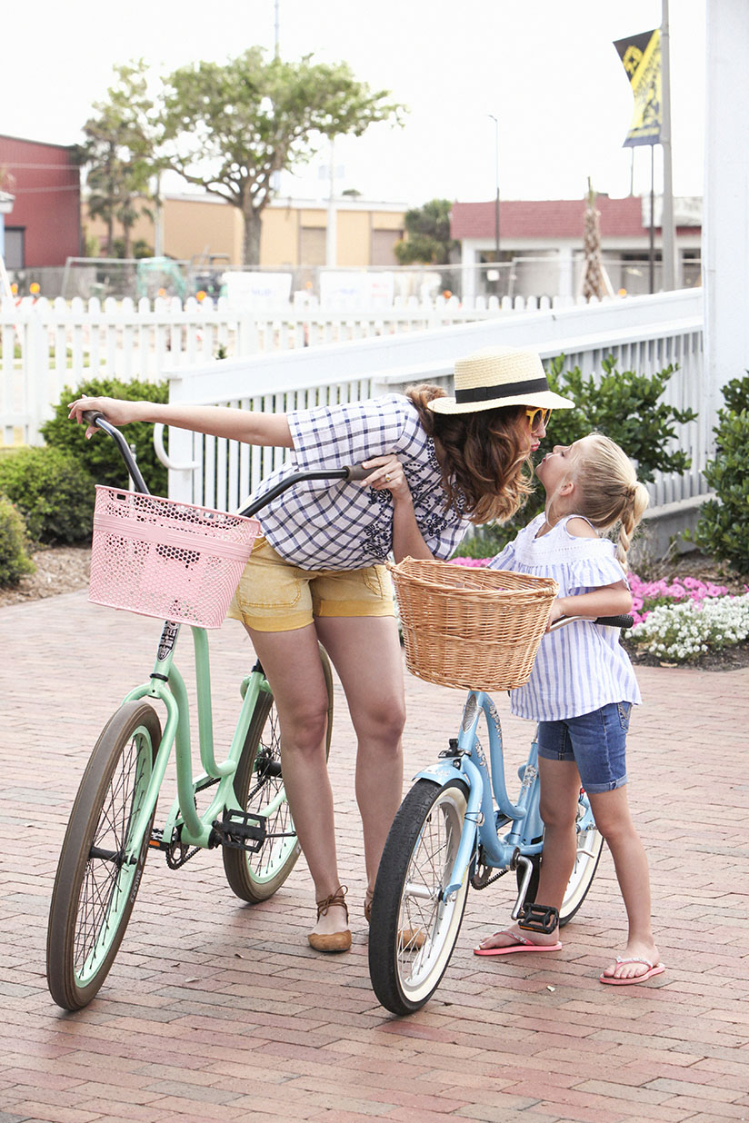 Amy West and daughters riding their beach cruisers