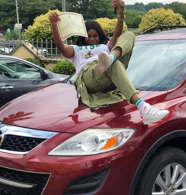 Fish seller buys herself a car as a gift as she completes her NYSC