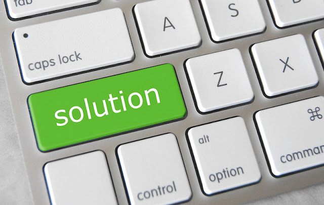 Keyboard showing green solutions key