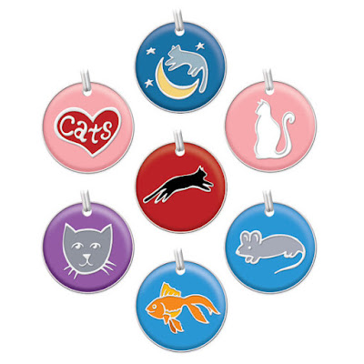 Never underestimate the importance of an ID tag for your cat. These handmade painted tags are adorable!