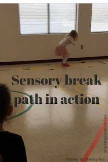 "Young child jumping along footprints on a classroom floor with the phrase ""Sensory break path in action""; Removing the Stumbling Block"