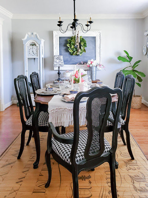 DIY Beautify dining room with black dining table and chairs, painted grandfather clock and French farmhouse chalkboard