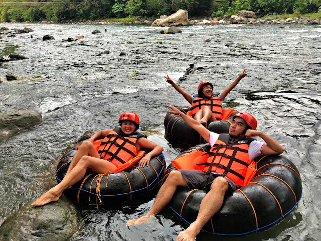 Karla Ramos and Erica Villa enjoying a river tubing session in Tibiao, Antique