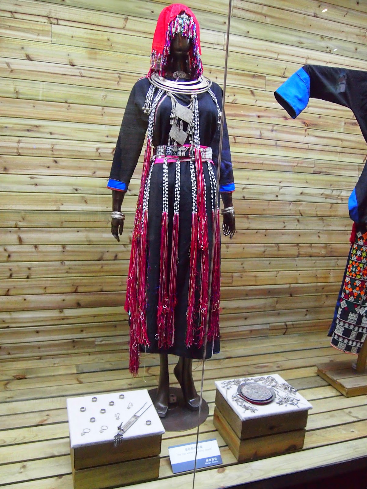 an ethnic minority woman's traditional outfit and jewelry from the Yunnan Nationalities Museum in Kunming, China