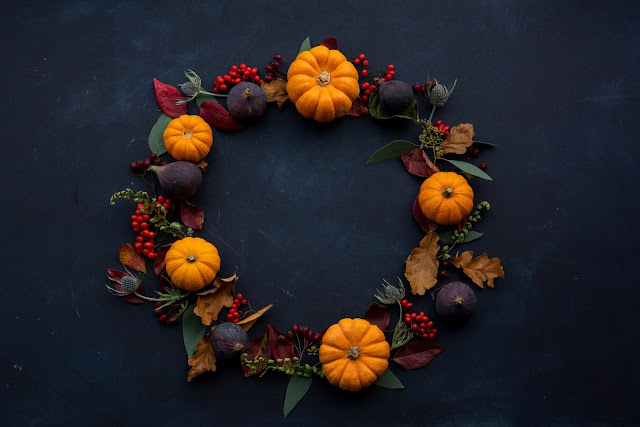 Pumpkin and fig wreath on a dark background