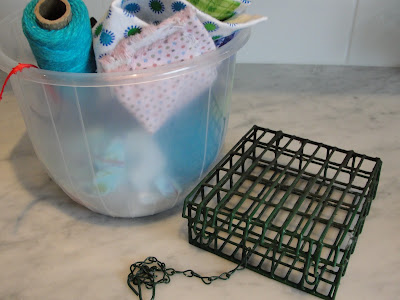 nesting supplies and suet cage