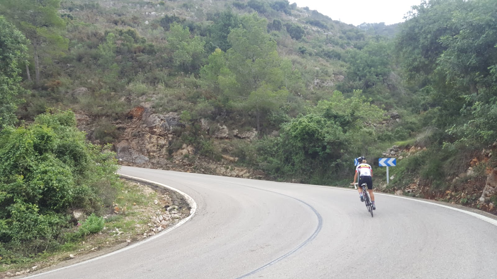 Cyclist climbing mountain pass in the province of Valencia