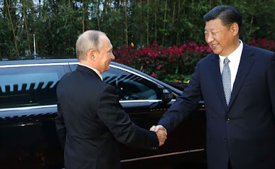 Vladimir Putin and President of the People's Republic of China Xi Jinping.