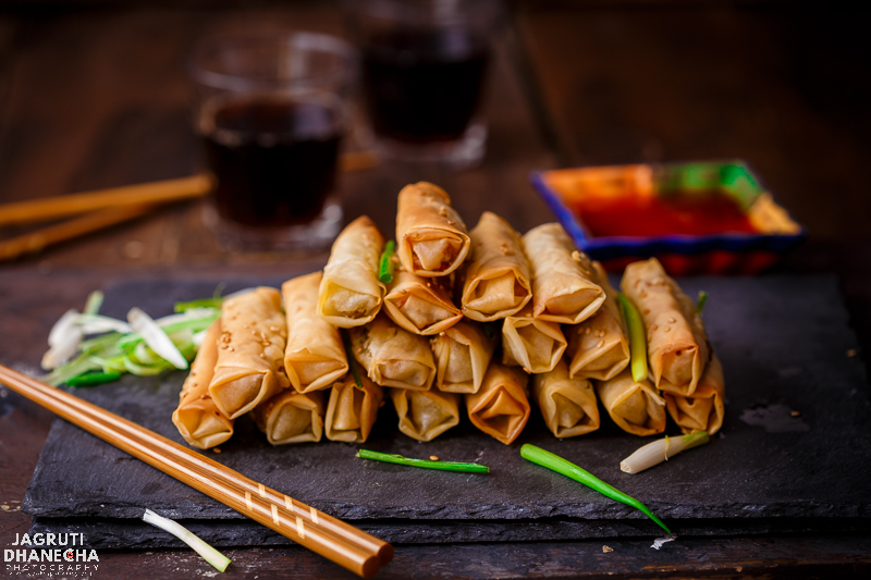 Baked Sesame Spring Rolls are a scrumptious and tasty Indo-Chinese appetiser or anytime snack that are homemade too. They are packed with freshness and flavours.  These are baked, so of course, you can indulge in more. Just don't forget to enjoy while they are HOT and dip in a sweet and spicy sauce!