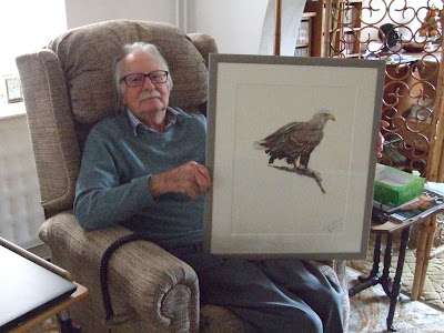 Frank Cottrell with the painting of a white-tailed eagle