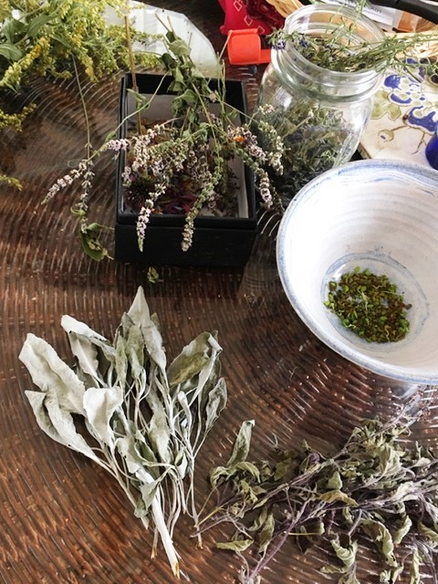 kitchen table with dried herbs