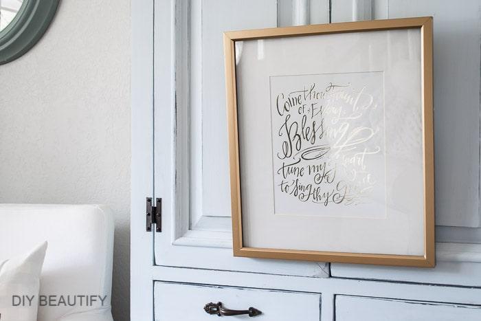 framed print hanging on hutch