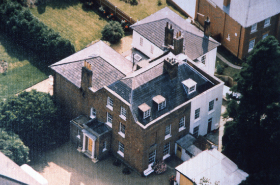 A picture of Moffats, formerly one residence, showing the mansard roof
