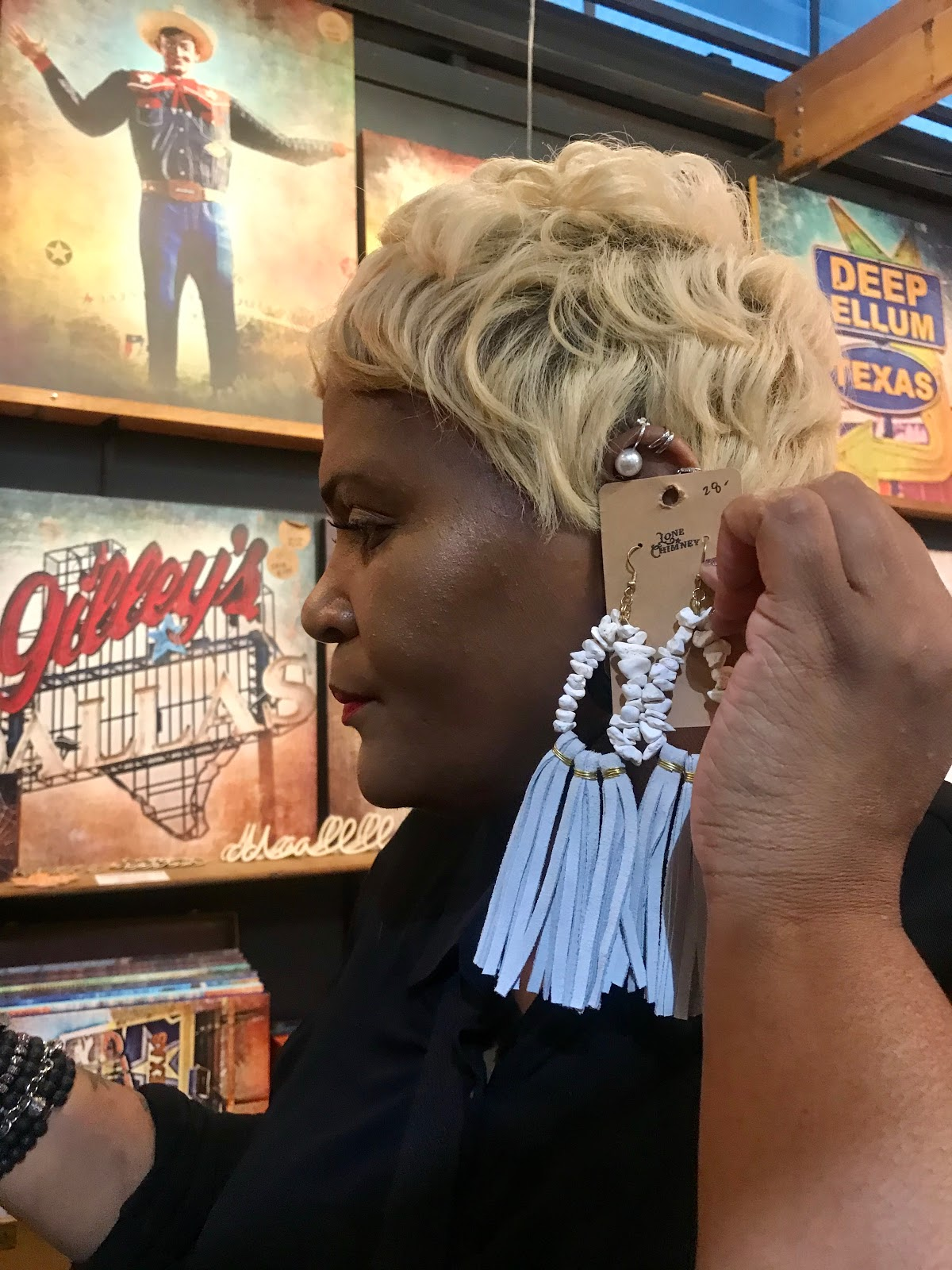 Tangie Bell Blogger trying on earring at the Dallas Farmers Market. The earrings she purchased were by Lone Chimney