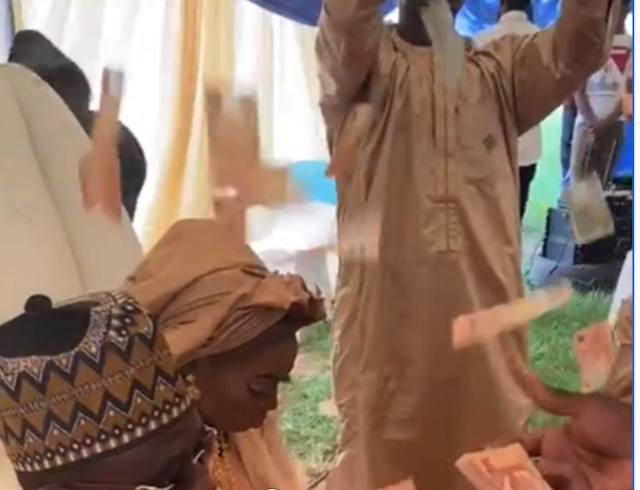 Quality not quantity: Nigerian couple visibly upset over their friends spraying them with neat N10 notes on their wedding day (video)