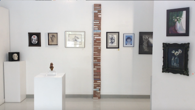 The Writing is on the wall; 45 brick art installation stefanie Girard sculpture