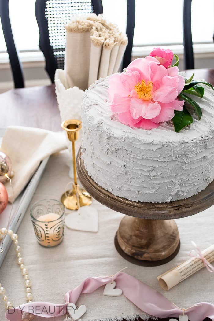 pink camelia on fake cake