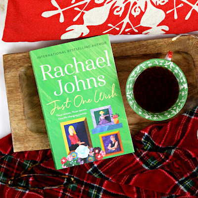 Just One Wish Rachael Johns Book Review Book on Wooden Tray with Red Tartan Blanket and Red Snowflake Cushion